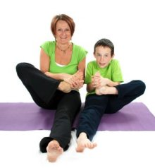 Mum and son enjoy a family yoga session
